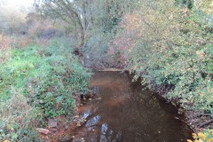 A. Upstream from Reservoir